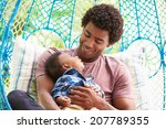 Father With Baby Son Relaxing...