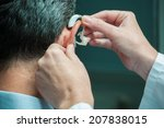 doctor inserting hearing aid in ... | Shutterstock . vector #207838015