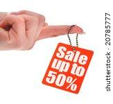 hand holding sale tag, photo does not infringe any copyright, shallow DOF - stock photo