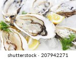oysters with lemon and dill on...   Shutterstock . vector #207942271