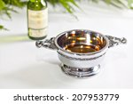 Small photo of Traditional Scottish quaich filled with single malt whisky