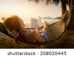 young lady reading a book in... | Shutterstock . vector #208020445