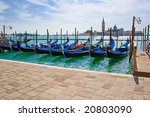 gondolas anchored on Grand Canal in Venice - stock photo