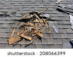 Small photo of Roof construction site. Removal of old roof, replacement with new shingles, equipment and repair. Roofs are a very important part of all housing projects around the world.