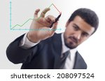 businessman drawing graph with... | Shutterstock . vector #208097524