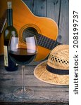 guitar and wine on a wooden... | Shutterstock . vector #208199737
