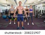 fitness class lifting barbells... | Shutterstock . vector #208221907