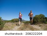 active couple jogging in the... | Shutterstock . vector #208222204