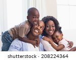 happy family posing on the... | Shutterstock . vector #208224364