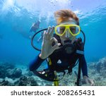 Female Scuba Diver Underwater...