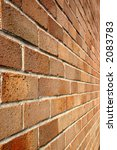 Looking along a modern brick wall - stock photo