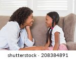 pretty mother sitting on the... | Shutterstock . vector #208384891