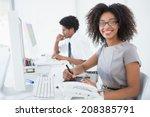 young pretty designer smiling... | Shutterstock . vector #208385791