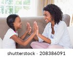 pretty mother playing clapping... | Shutterstock . vector #208386091