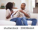 unhappy couple arguing on the... | Shutterstock . vector #208386664