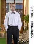 young waiter standing in coffe... | Shutterstock . vector #2083911