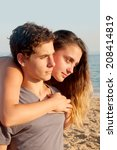 young couple at the beach | Shutterstock . vector #208414819