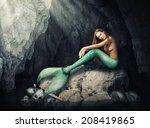Beautiful Woman Mermaid Sittin...