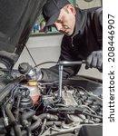 auto mechanic replacing glow... | Shutterstock . vector #208446907