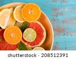 different sliced juicy citrus... | Shutterstock . vector #208512391