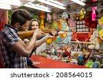 young fun couple playing... | Shutterstock . vector #208564015
