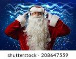 santa claus wearing headphones... | Shutterstock . vector #208647559