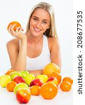 Smiling pretty woman with fruits - stock photo