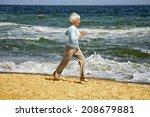 elderly happy woman running on... | Shutterstock . vector #208679881