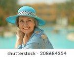nice smiling senior woman at... | Shutterstock . vector #208684354