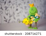 Knitted Toy frog with yellow flowers and small bear