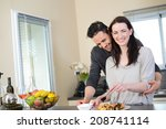 cheerful young couple preparing ... | Shutterstock . vector #208741114