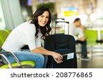 happy woman waiting for flight... | Shutterstock . vector #208776865