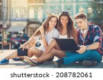 happy college students on campus | Shutterstock . vector #208782061