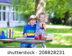 two laughing kids happy being... | Shutterstock . vector #208828231