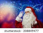 santa claus enjoying sound of... | Shutterstock . vector #208849477