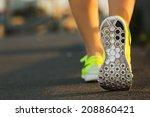 runner woman feet running on... | Shutterstock . vector #208860421