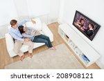 full length of relaxed couple... | Shutterstock . vector #208908121