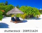 Beach chairs on the tropical sand beach - stock photo