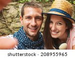 beautiful couple smiling in... | Shutterstock . vector #208955965