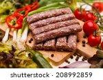 raw kebapcheta with vegetables... | Shutterstock . vector #208992859
