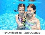 Happy Active Kids Swim In Pool...