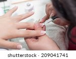 manicure in salon | Shutterstock . vector #209041741