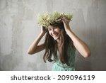 beautiful brunette girl with a... | Shutterstock . vector #209096119