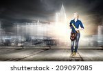 young pretty woman engineer... | Shutterstock . vector #209097085