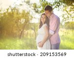 happy and young pregnant couple ... | Shutterstock . vector #209153569