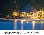 resort at sea in night | Shutterstock . vector #209156791