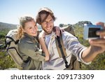 hiking couple standing on...   Shutterstock . vector #209173309