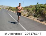 athletic man jogging on open... | Shutterstock . vector #209176147