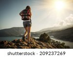 young tourist woman is hiking... | Shutterstock . vector #209237269