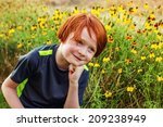 7 year old boy playing outside... | Shutterstock . vector #209238949